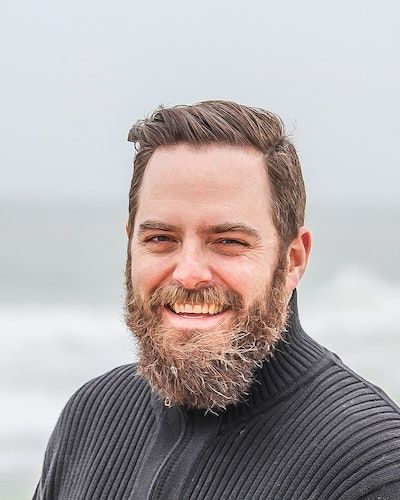 man smiling on beach